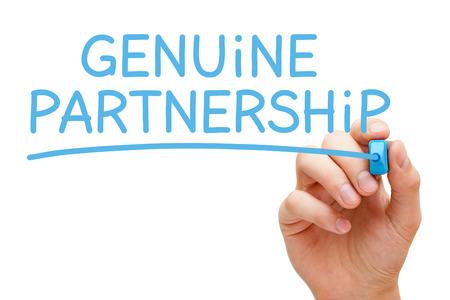 legitimate: Hand writing Genuine Partnership with blue marker on transparent wipe board. Stock Photo