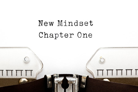 mentality: New Mindset Chapter One printed on an old typewriter. Stock Photo