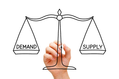 Hand drawing Demand Supply scale concept with black marker on transparent wipe board isolated on white.