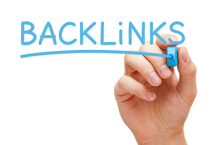 linkbuilding: Hand writing Backlinks with blue marker on transparent wipe board.
