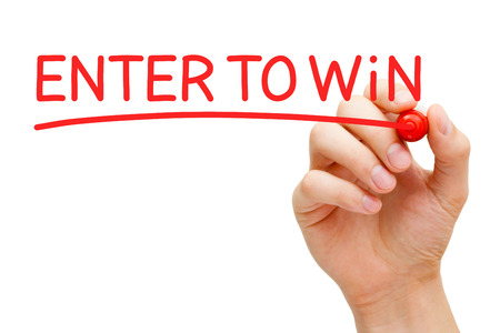 to enter: Hand writing Enter to Win with red marker on transparent wipe board.