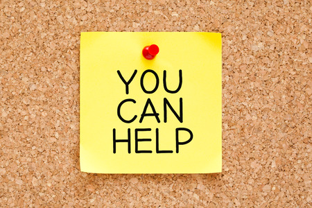 You Can Help handwritten on yellow sticky note. photo