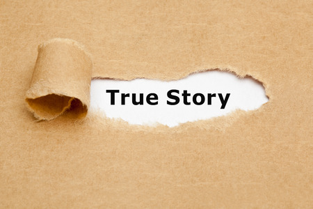 factual: The phrase True Story appearing behind torn brown paper. Stock Photo
