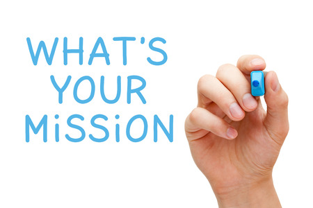 meaning: Hand writing Whats Your Mission with blue marker on transparent wipe board.