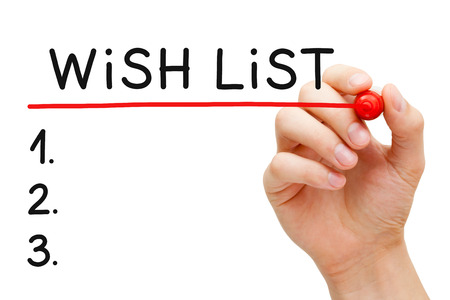wishlist: Hand underlining Wish List with red marker isolated on white. Stock Photo