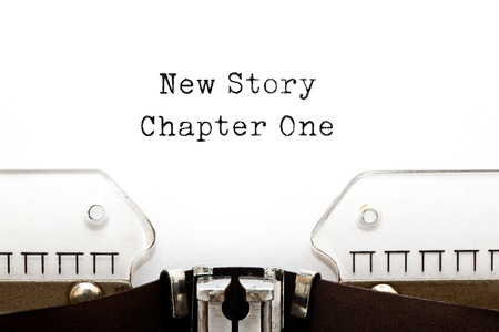 narration: New Story Chapter One printed on a vintage typewriter. Stock Photo