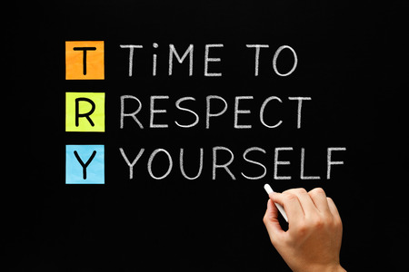 self worth: Hand writing Time to Respect Yourself with white chalk on blackboard. Self-respect concept. Stock Photo