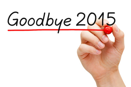 sequential: Hand underlining Goodbye 2015 with red marker isolated on white.