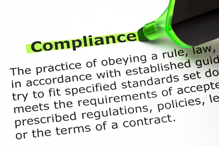 felt tip: Definition of the word Compliance, highlighted with green felt tip pen.