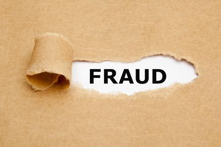 The word Fraud appearing behind torn brown paper.