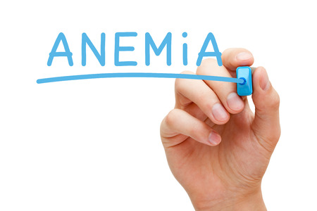 anemia: Hand writing Anemia with blue marker on transparent wipe board.