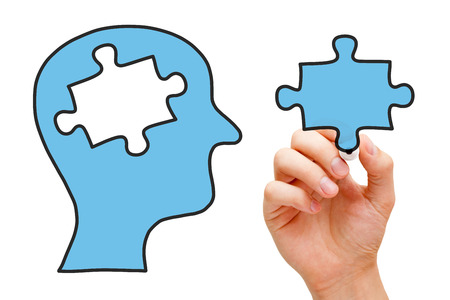 educational problem solving: Hand drawing human head with missing piece of puzzle in the middle. Stock Photo