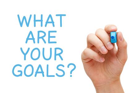 Hand schrijven Wat zijn je doelen met blauwe marker op transparante veeg boord.