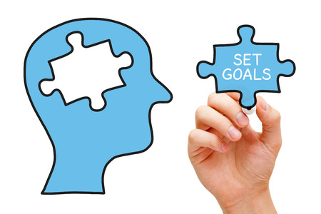 setting goals: Hand drawing Setting Goals concept. Human head with missing piece of puzzle in the middle. Stock Photo