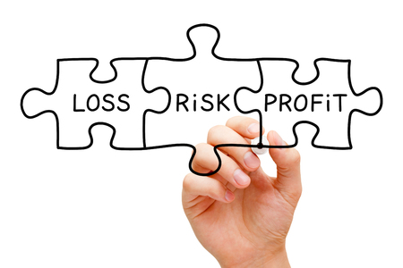money risk: Hand drawing Risk Loss Profit puzzle concept with black marker on transparent wipe board isolated on white.