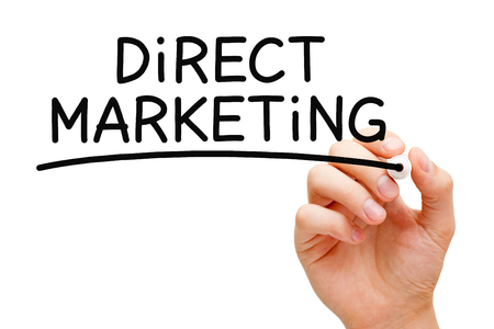 direct marketing: Hand writing Direct Marketing with black marker on transparent wipe board. Stock Photo