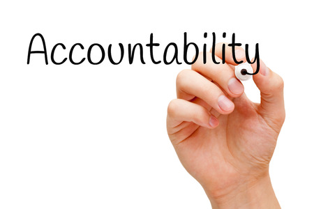 account executive: Hand writing Accountability with black marker on transparent wipe board. Stock Photo