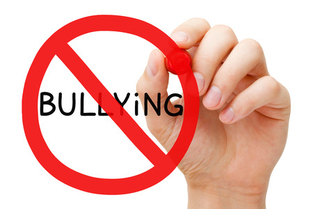 violence in the workplace: Hand drawing Bullying prohibition sign with red marker on transparent wipe board. Stop Bullying Concept.