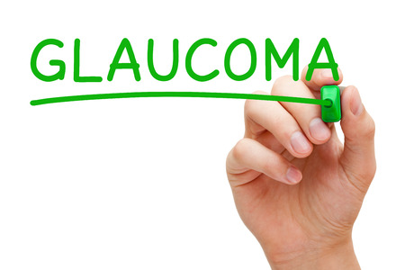 glaucoma: Hand writing Glaucoma with green marker on transparent wipe board.