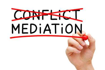 conflicting: Hand writing Mediation concept with marker on transparent wipe board. Mediation - to resolve or settle differences by working with all the conflicting parties.