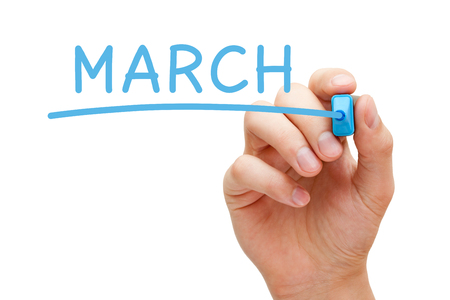 march: Hand writing March with blue marker on transparent wipe board. March is the third month of the year in which beginning of spring occurs.