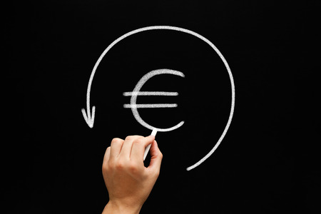 reclamation: Hand sketching Euro sign in arrow circle with white chalk on blackboard. Refund concept. Stock Photo