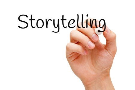 narration: Hand writing Storytelling with black marker on transparent wipe board. Stock Photo