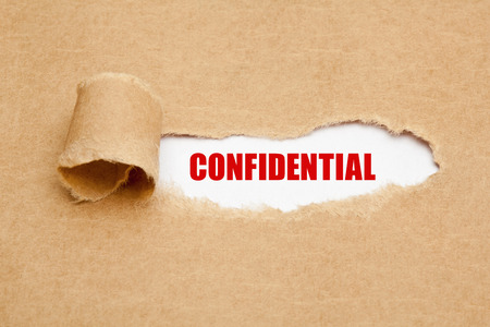 appearing: The word Confidential appearing behind torn brown paper.