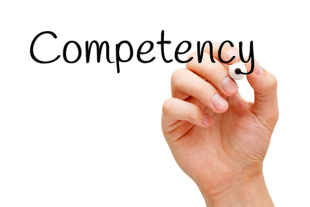 suitability: Hand writing Competency with black marker on transparent wipe board. Stock Photo