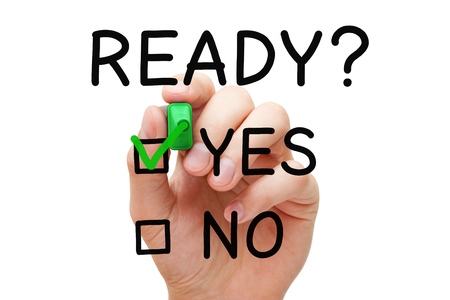Hand putting check mark with green marker on Yes Ready. Readiness concept. Stock Photo