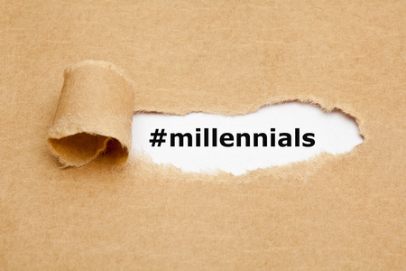 generational: Hashtag Millennials appearing behind torn brown paper. Millennials, also known as Generation Y, are the demographic cohort following Generation X.