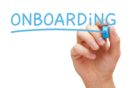 Hand writing Onboarding with blue marker on transparent wipe board isolated on white. Foto de archivo