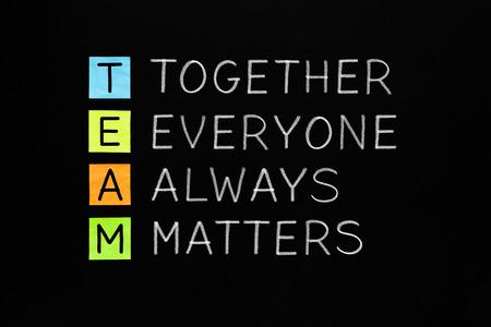 matters: TEAM acronym Together Everyone Always Matters handwritten with white chalk on blackboard. Teamwork concept.