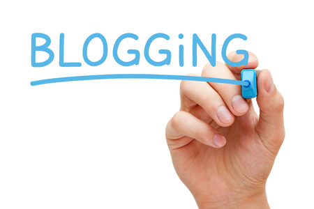 weblog: Hand writing Blogging with blue marker on transparent wipe board. Stock Photo