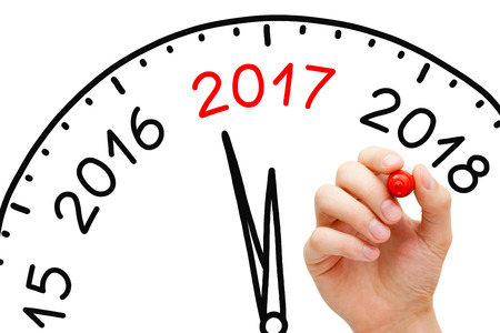 Hand drawing New Year 2017 clock concept with marker on transparent wipe board.