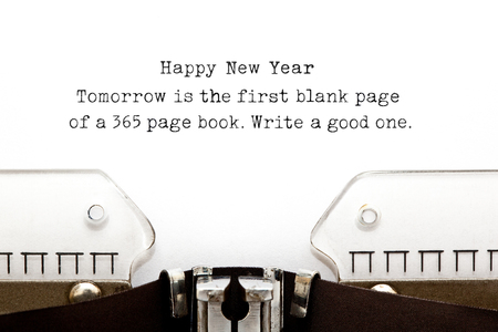next year: Tomorrow is the first blank page of a 365 page book. Write a good one. New Year quote printed on an old typewriter.