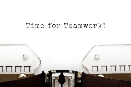 synergism: Time For Teamwork typed on retro typewriter.