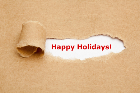 appearing: Red text Happy Holidays appearing behind ripped brown paper.