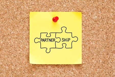 Partnership Jigsaw Puzzle Concept Sticky Note Stock Photo
