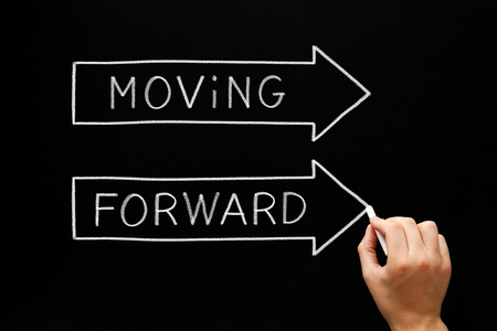 Moving Forward Arrows Concept On Blackboard Stock Photo