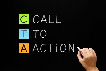 Hand writing business acronym CTA - Call To Action marketing concept with white chalk on blackboard. Stock Photo