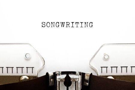 The word Songwriting typed on vintage typewriter with copy space. Banco de Imagens - 129542391