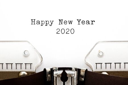 Text Happy New Year 2020 typed on vintage typewriter with copy space. Stock Photo