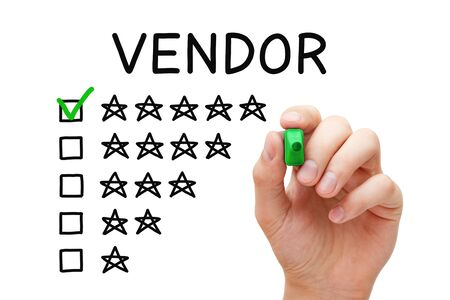 Satisfied customer putting check mark with green marker on five star rating in vendor evaluation feedback form. Stock Photo