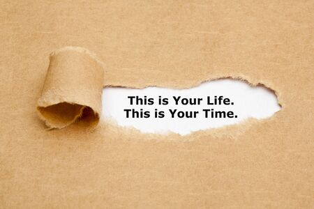 Motivational quote This is Your Life This is Your Time appearing behind torn brown paper. Stock Photo