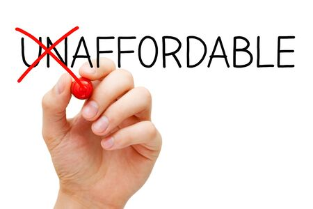 Hand writing a concept changing the word Unaffordable into Affordable with red marker isolated on white background.