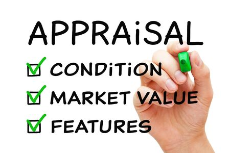 Hand filling Appraisal checklist business concept with checked boxes on condition, market value and features.