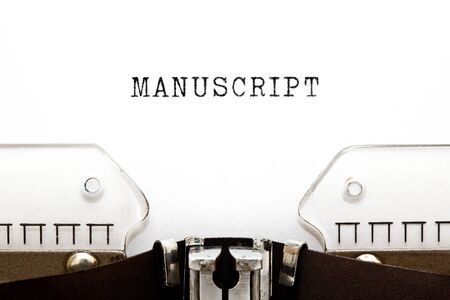 The word Manuscript typed on retro typewriter with copy space.