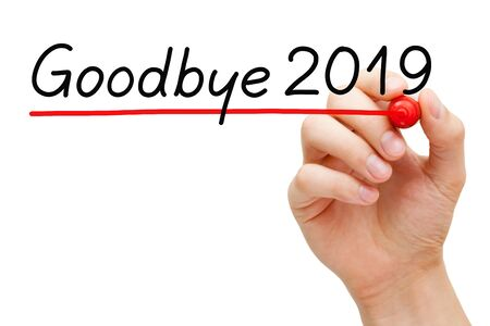 Hand underlining text Goodbye year 2019 with red marker isolated on white background. Stock Photo