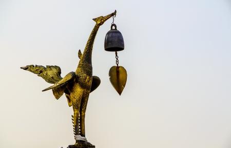swan iron statue gold thailand photo
